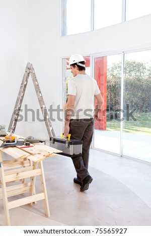 A faceless man with a tool chest, working on home improvements - stock photo
