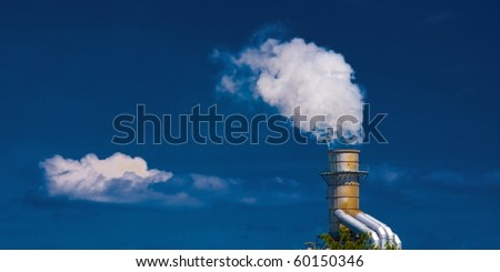 a factory chimney looks like it's making clouds!
