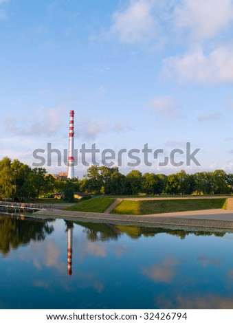 A factory chimney near water in Klaipeda, Lithuania