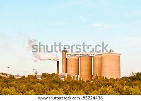 A factory emitting steam in the late afternoon sunlight in the UK
