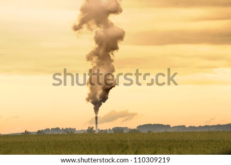 A factory polluting the environment. - stock photo