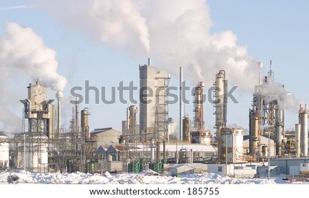A Factory with smokestacks. - stock photo