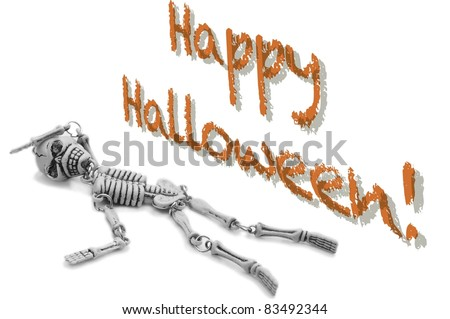 """A Fainted Skeleton Lies on a White Background Beneath the Message, """"Happy Halloween"""" - stock photo"""