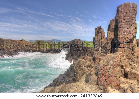 A fair swell at Bombo kicked up large waves that smashed the  clusters of hexagonal basalt columns which are an internationally recognised geological phenomena formed from volcanic action.