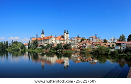 A fairy tale castle and old town city with lakeside mirror reflection in Telc, Czech Republic - stock photo