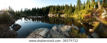 A fall late afternoon in the forest at Mystery Lake on Mount Seymour, British Columbia, Canada - stock photo