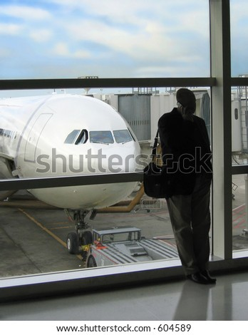 A familiar pose while waiting for the flight to leave - stock photo
