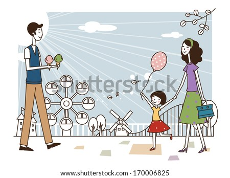 A family at an amusement park. - stock photo