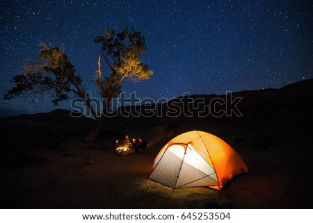 A Family Camping By Campfire In The Utah Desert USA
