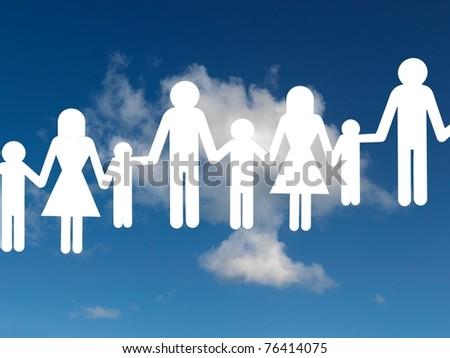 A family cutout shape isolated against a blue sky - stock photo