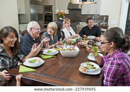a family dinner / the family interaction / that is happening - stock photo