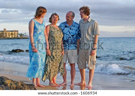 A family enjoying their tropical vacation - stock photo