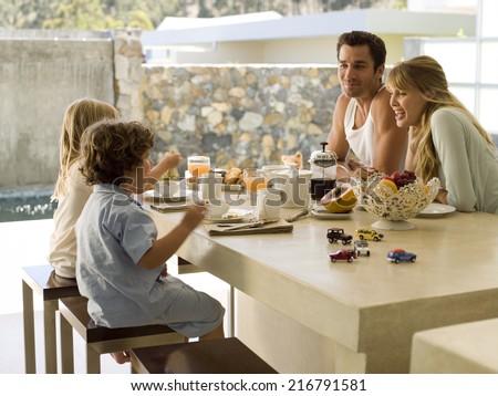 A family having breakfast. - stock photo