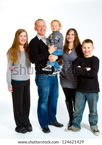 A family of five people on a white isolated background in the studio.