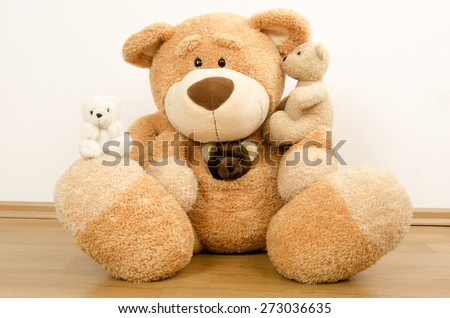 A family of teddy bears, big bear protecting the smaller ones, bear toys - stock photo
