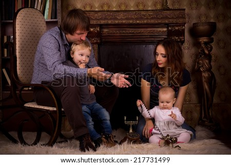 a family on a fluffy carpet by the fireplace