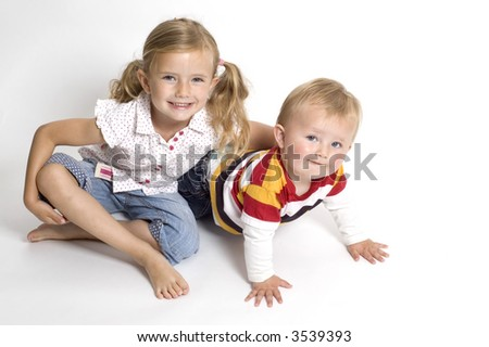A family scene of a brother and sister sat together - stock photo