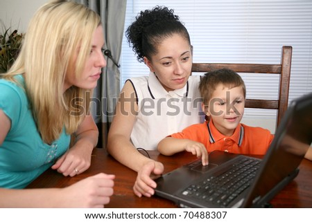 A family sitting at their computer looking on the internet