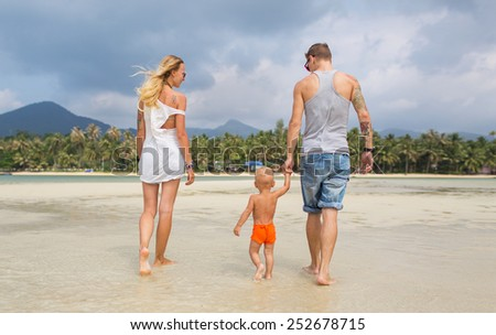 A family spending their leisure time on the beach.  - stock photo