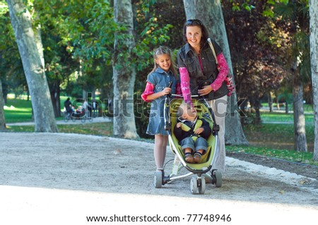 A family walking in the park in the summer day - stock photo