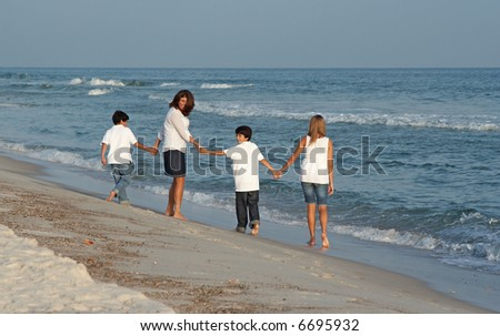 A family walking on the beach together.