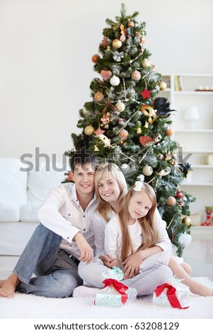 A family with a daughter in the background of trees - stock photo