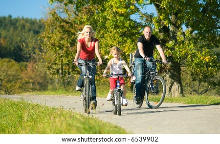 A family with children having a weekend excursion on their bikes - stock photo