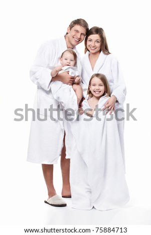 A family with two children in robes on a white background