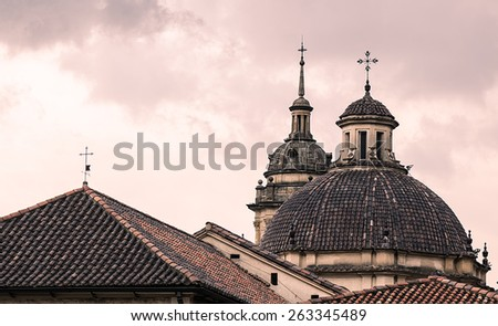 A famous cathedral in Bogota, Colombia, with a red sky behind it (second view) - stock photo