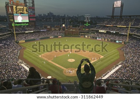 A fan with a digital camera taking a panoramic image of Citizens Bank Park Philadelphia, PA, one of 29183 watching Philadelphia Phillies beat the Milwaukee Brewers by a score of 8 to 6 on May 14, 2007
