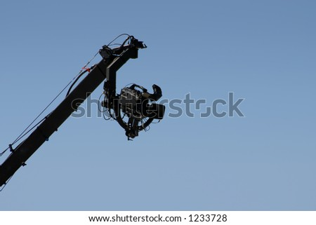 A fancy video camera high-up on a boom arm.