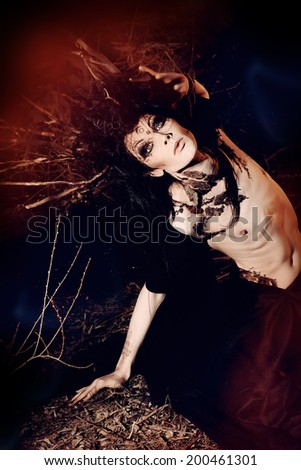 A fantasy hero in a wild desolate forest. Art project. Fantasy. Halloween. - stock photo