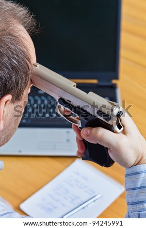 a farewell letter and the gun of a suicide. - stock photo