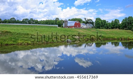 A farm landscape with duck pond in Vermont. - stock photo