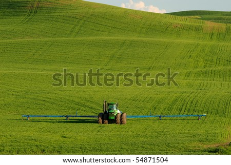 A Farm tractor, set against the green wheat fields of eastern Washington's Palouse.
