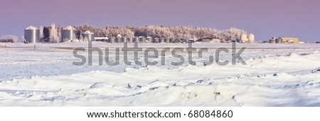 A farm yard in the  frosty winter wonderland on the prairies. - stock photo
