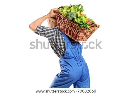 A farmer carrying a basket of vegetables on his back isolated on white background - stock photo