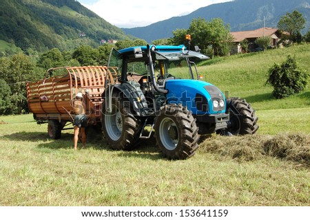 A farmer harvests  hay
