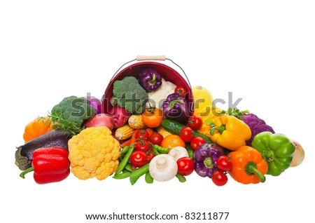 A farmer's market display of fresh vegetables with a red bushel basket.  Shot on white background. - stock photo