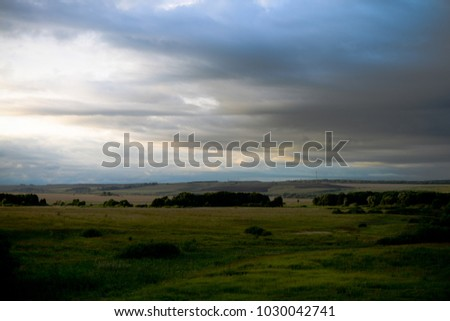 A fascinating landscape of Russian lands under the cloudy sky