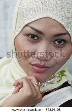 A Fashion Portrait of a Beautiful young Indonesian Muslim Woman in Sumatra! - stock photo