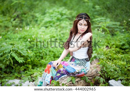 A fashion shot of a beautiful asian woman outdoor