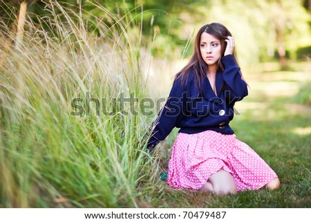 A fashion shot of a beautiful asian woman outdoor - stock photo