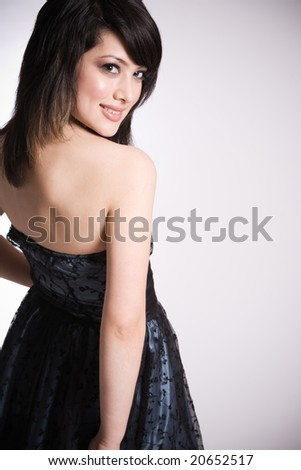 A fashion shot of beautiful smiling asian girl - stock photo