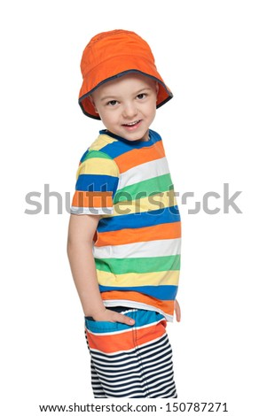 A fashion smiling little boy on the white background