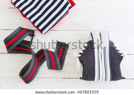A fashionable set for children - footwear, belt and t-shirt. Children's clothes