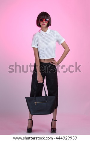 A fashionable young girl wearing sunglasses, holding a black purse, full body