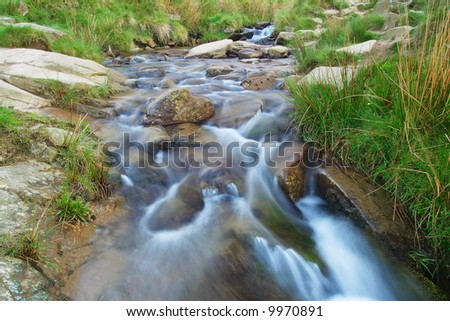 A fast flowing stream - stock photo