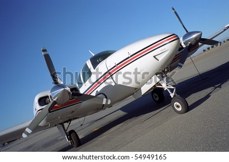 A fast modern twin-engine aircraft for business use - stock photo