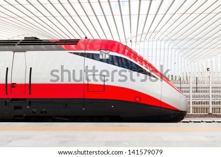 a fast train in the new station of Reggio Emilia in Italy - stock photo